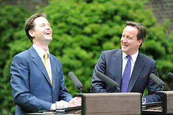 UK PM David Cameron (r) and deputy PM Nick Clegg (l) share a joke as coalition is unveiled