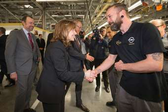 from left, GM president Dan Ammann, CEO Mary Barra and Opel CEO Karl-Thomas Neumann tour the Rüsselsheim assembly plant on Monday
