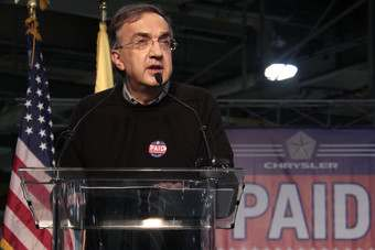 In trademark black sweater and pants, Marchionne announces a federal loan had been repaid in this file photo from last May