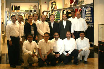 Giordano International chairman Dr Peter Lau with Giordano Middle East team