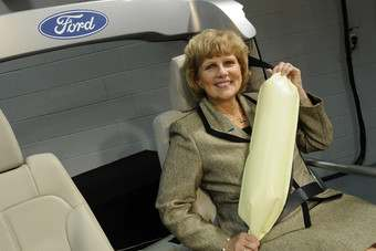 Ford safety chief Sue Cischke shows off the Explorers rear seatbelt/airbag combination in November 2009