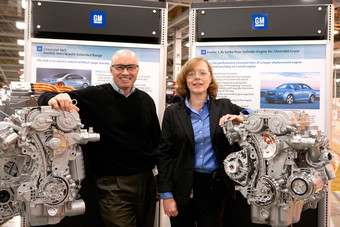 Bay City Powertrain plant manager Joe Mazzeo (left) and Flint Powertrain plant manager Kathleen Dilworth pose with 1.4-litre engines their plants will soon be producing