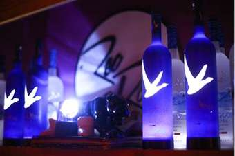 The bottle is underlit by LED lights
