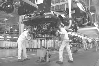 Workers at the original Marysville, Ohio car plant (next door to the motorcycle factory) install the engine in an early build Accord 30 years ago