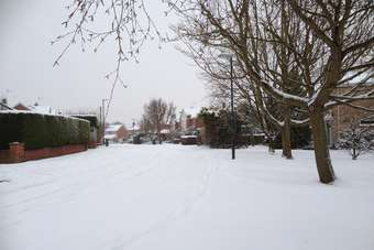 Snow starts, Britain stops (footpath/sidewalk clearance by residents is not mandatory; only main roads are cleared)