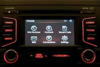 UVO configured for US Kia drivers (Sirius is satellite radio). SMS is likely to be changed to text or text message for the UK where a cellphone is a mobile.