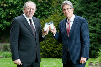 Arla UK CEO Peter Lauritzen and Milk Link CEO Neil Kennedy toast the proposed merger of the two groups