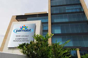 Parmalats profits were down on reduced settlement costs