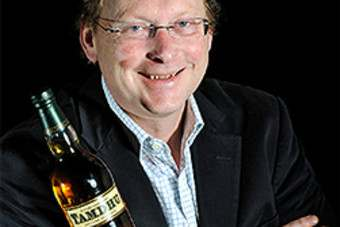 Ian Macleod Distillers MD Leonard Russell with a bottle of Tamdhu single malt Scotch