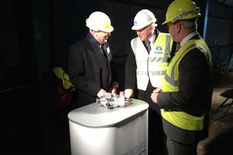 Torotrak CEO, Jeremy Deering, left, shows UK Business Secretary, Vince Cable, the V-Charge boost