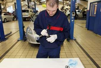 A Toyota technician in the UK modifying an accelerator for the global sticky pedal recall