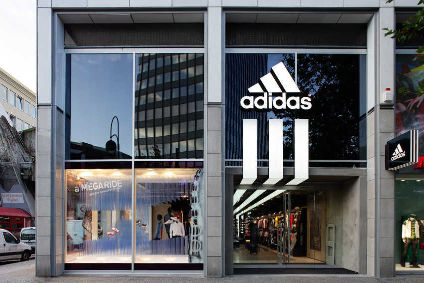 Adidas narrowed its fourth-quarter net loss