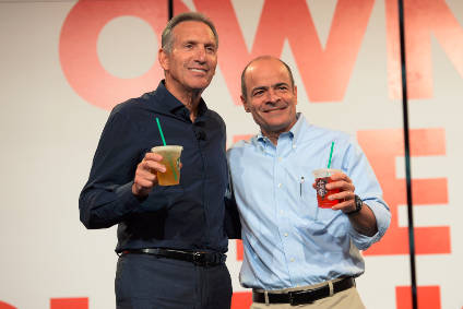 Starbucks CEO Howard Schultz and Anheuser-Busch InBev CEO Carlos Brito raise an iced tea to their new Teavana RTD venture