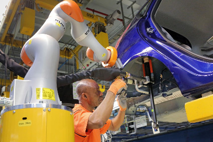 C-bot assists line worker with Fiesta suspension strut installation