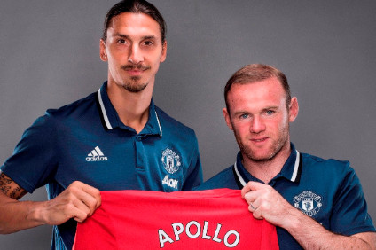 New Manchester Utd signing, Zlatan Ibrahimovic and captain, Wayne Rooney, pose with an Apollo shirt