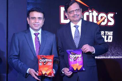 "PepsiCo India VPs Jagrut Kotecha (left) and Niteen Pradhan launch ""made-in-India Doritos"""