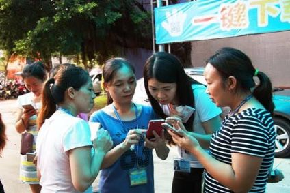 Crystal International's workers trying out the Company IQ app