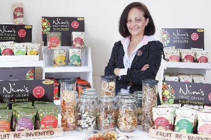Nimisha Raja with some of her Nims Fruit Crisps products.
