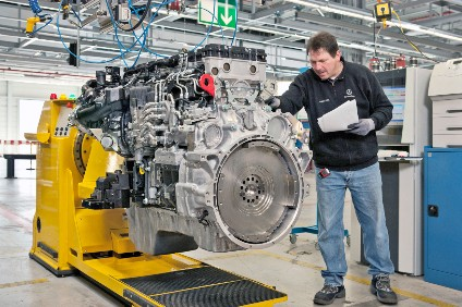 A completed I6 engine receives final checks at Daimler Trucks Mannheim plant