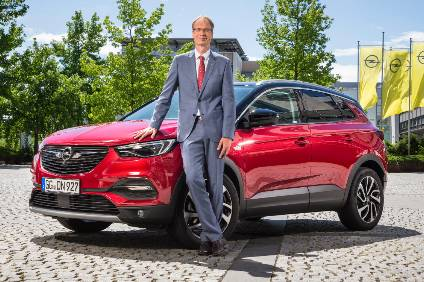 Opel CEO Michael Lohscheller with the Opel Grandland X which will be built in Germany (Eisenach) from next year (made in France - Sochaux - currently)