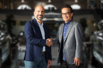 Working together: Dara Khosrowshahi, Ubers CEO and Shigeki Tomoyama, Toyota exec VP and head of Toyota Connected Company
