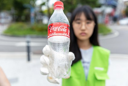 Soft drinks firms named in plastic waste report tell Greenpeace: