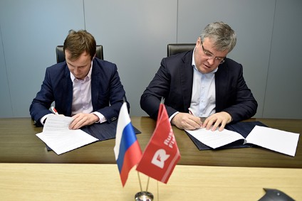 Company CEOs Fedor Kirsanov and Yuri Alasheev sign agreement