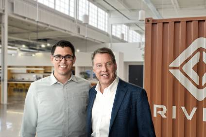 RJ Scaringe, Rivian founder and CEO, and Ford Executive Chairman Bill Ford announce a $500 million Ford investment in Rivian