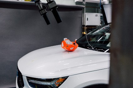 POC bike helmets are worn by crash dummy heads mounted on a testing rig, from where they are launched towards different areas of the bonnet of a static car, at different speeds and angles for various measurements