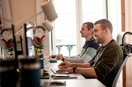 Software developers Leo Dias (right) and Tiago Mendes at their work station at the VW Software Development Centre in Lisbon