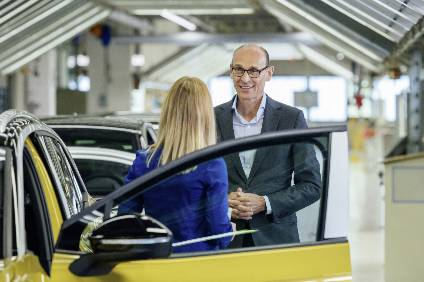 Volkswagen brand CEO Ralf Brandstätter standing next to the first series vehicle at the start of ID.4 series production in Zwickau