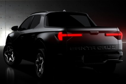 Teaser shows a four door cab. There will be powertrain choices and all wheel drive