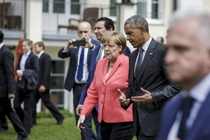 German Chancellor Angela Merkel talks with US President Barack Obama at the G7 Summit
