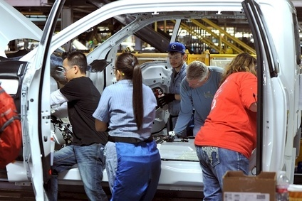 Ford hired 900 new workers to add the F-150 at its Kansas City plant