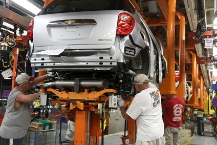 Robert Honaker (l to r), William Stewart and Doug Cain assemble a Chevrolet Equinox at the General Motors Spring Hill manufacturing complex in Spring Hill, Tennessee. GM said it would spend $185m to make small petrol engines at the complex, retaining 390 jobs. It also announced the next-generation Cadillac SRX mid-size vehicle will be produced at Spring Hill, honouring an earlier collective bargaining agreement with the UAW to shift production from Mexico