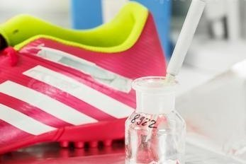 Soccer shoes from Adidas, Nike and Puma were tested for hazardous chemicals at the Bremer Umweltinstitut, an independent research laboratory in Germany. (Photo credit: Greenpeace / Holger Weber)