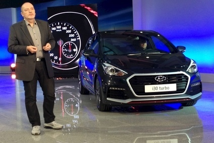 Hyundai Motor Europe design chief Thomas Bürkle shows off the new i30 Turbo, one of several new sports models that will replace the slow-selling and just axed Veloster coupe