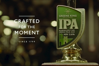 Greene King said its own-brand beer volumes were up