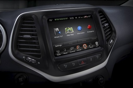 The uConnect infotainment system in a 2015 Jeep Cherokee. Suppliers such as Harman customise their systems to automakers requirements