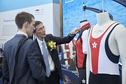 HKRITA CEO Edwin Keh showcases competition suits designed for the Hong Kong rowing team