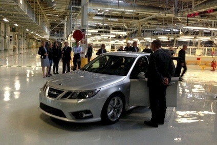 Happier times: A photo taken soon after NEVS restarted Saab 9-3 production. Financial difficulties idled the line in May 2014 but the remaining 100 cars will now be finished
