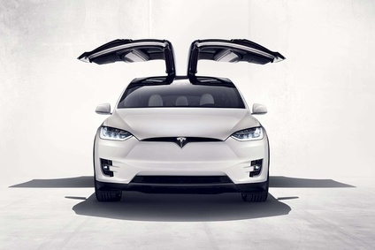 Tesla's long-awaited Model X crossover has gullwing doors with some high tech features