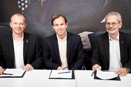 IndustriALL general secretary Jyrki Raina, H&M CEO Karl-Johan Persson and IF Metall president Anders Ferbe sign the global framework agreement
