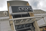 Next shares slide as FY profit outlook cut