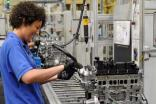 Employees at Ford's Bridgend Engine Plant, UK, building the 1.6-litre EcoBoost engine