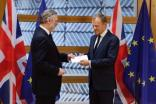 The UK's ambassador to the EU, Sir Tim Barrow, handing European Council President Donald Tusk the UK's invocation of Article 50