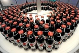 "Coca-Cola Co FY profits tumble as CEO looks to ""transition year"""
