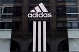 "Adidas remains ""on attack"" as sales climb"