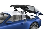 Roof system consists of four moving parts: glass canopy, canvas top and two pop-up flaps on roll-over hoop
