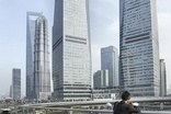 "Executive ""optimism"" on China but growth to slow - survey"